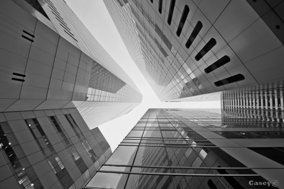 abstract B&W view looking up at the buildings