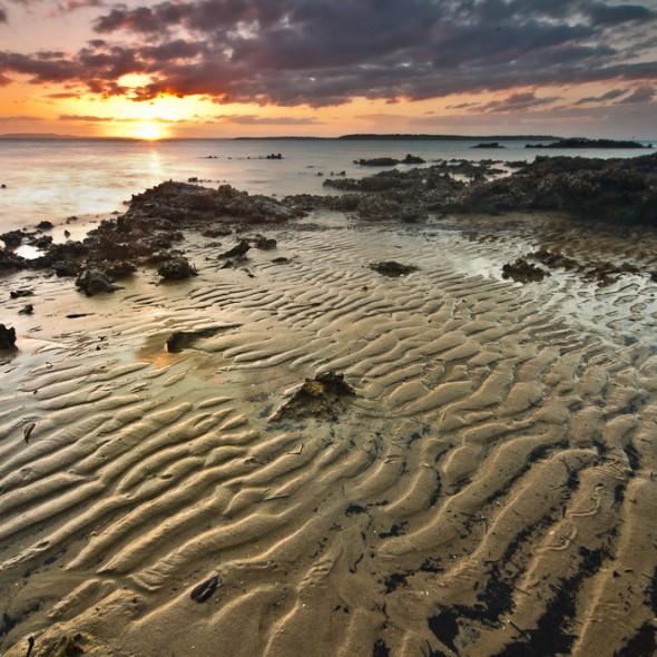 sand pattern and rocks sunset