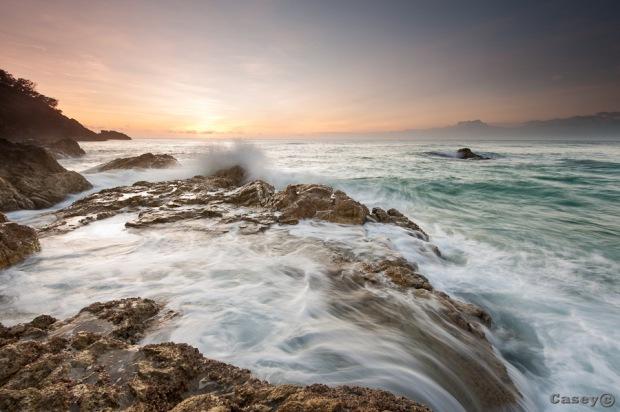surging surf sunrise