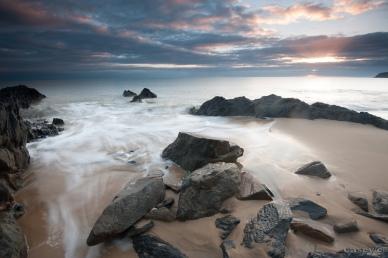 Tropics far north queensland rocks sunrise beach ocean sunrays