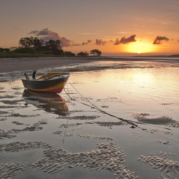 grounded boat anchored sunset Morton Bay